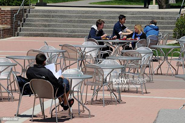 Students sit outside Harkness Commons on the Harvard Law School campus on May 10 2010 at Harvard University in Cambridge Massachusetts US President...
