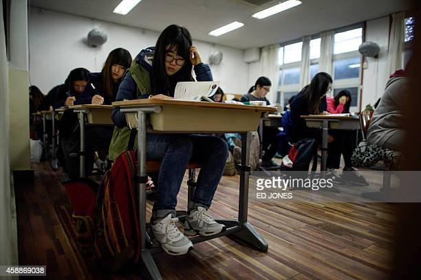 Students sit the annual Scolastic Aptitude Test at a the Poongmun high school in Seoul on November 13 2014 South Korea went into 'hush' mode as...