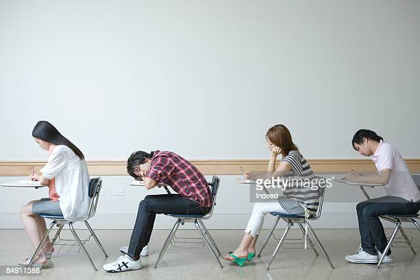 Students sitting at desk, side view