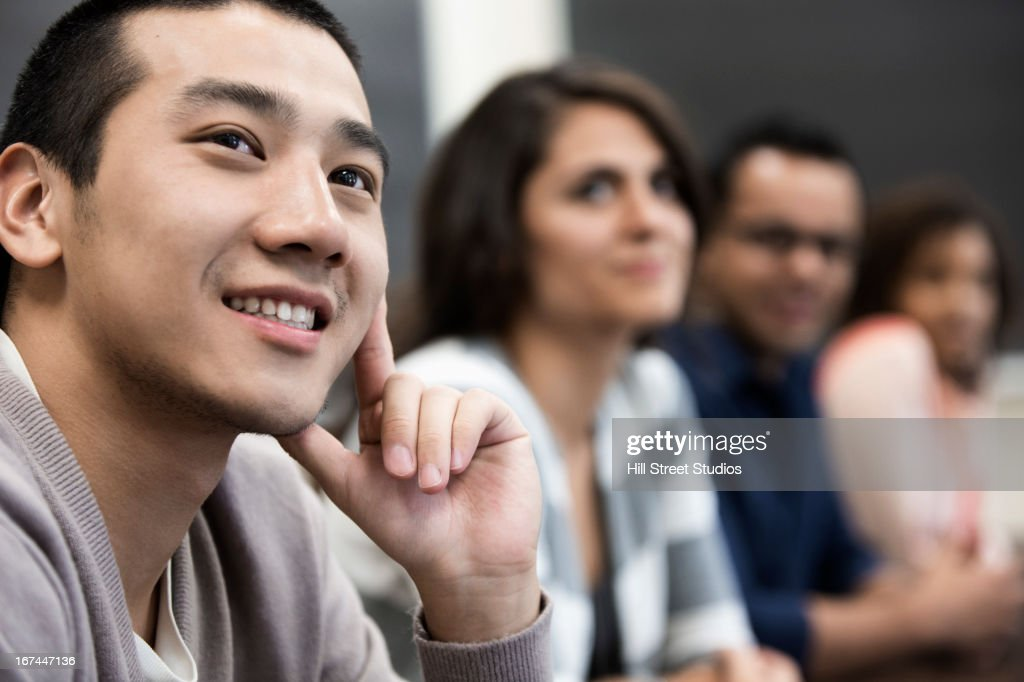 Students sitting in classroom : Stock Photo
