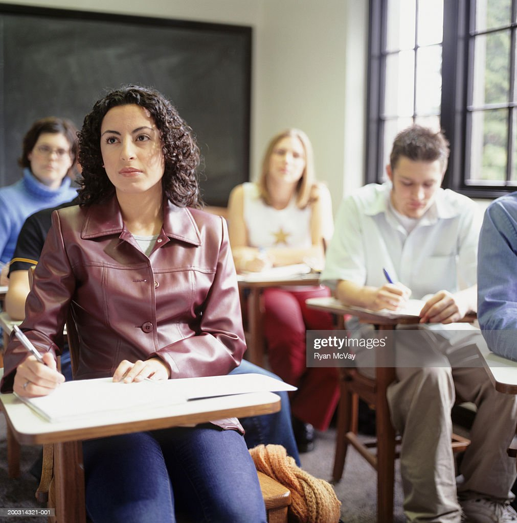 Students sitting in lesson, in classroom : Stock Photo