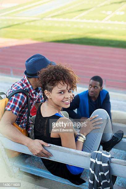 Students sitting together on bleachers