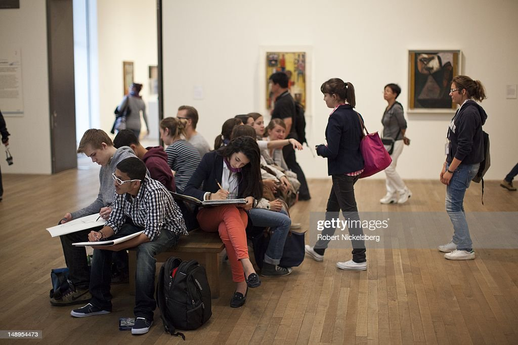 Students sketch works of art and paintings in a gallery at the Tate Modern Museum July 2, 2012 in London, England.
