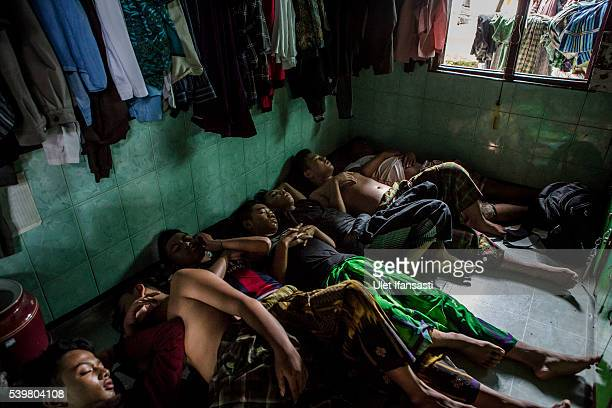 Students sleep inside their room at the islamic boarding school Lirboyo during the holy month of Ramadan on June 9 2016 in Kediri East Java Indonesia...