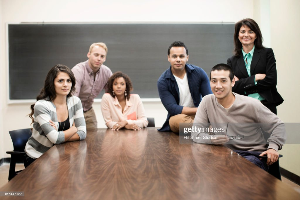 Students smiling in classroom : Stock Photo