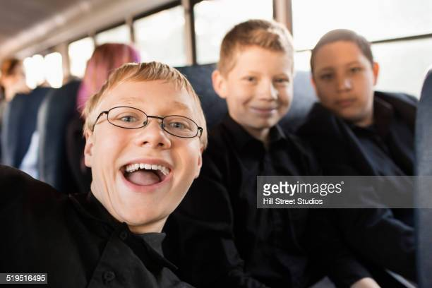 Students smiling on school bus