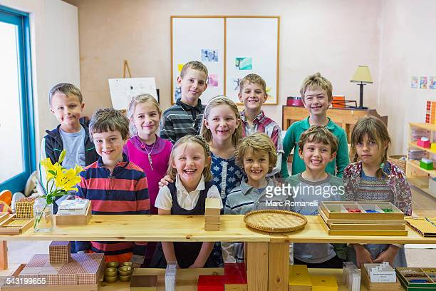 Students smiling together in classroom