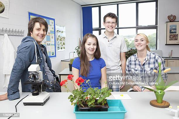 Students smiling together in lab