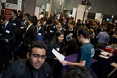 Students speak with representatives during an engineering and technology career fair at the New York University Polytechnic School of Engineering in...