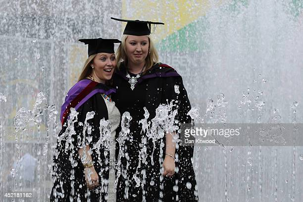 Students stand in a fountain ahead of their graduation ceremony at the Royal Festival Hall on July 15 2014 in London England Students of the London...