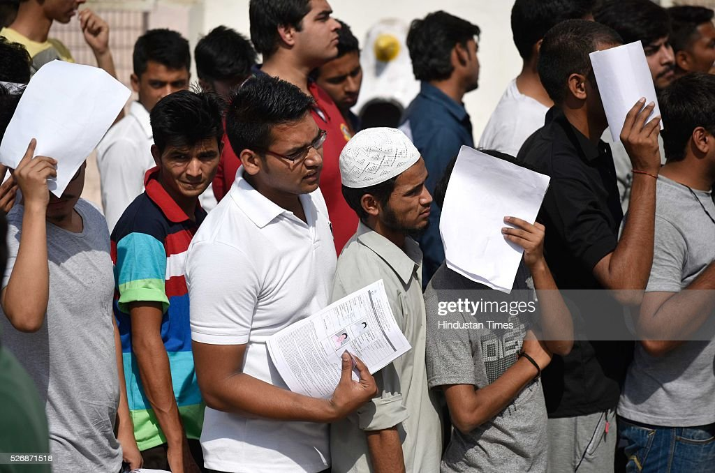 Students stands in queue at the gate of examination entree after they were thoroughly scanned to take the All India Pre-Medical/Pre-Dental Entrance Test (AIPMT) at the examination centre at RK Puram on May 1, 2016 in New Delhi, India. The All Indian Pre-Medical Test (AIPMT) 2016, being treated as the first phase of the National Eligibility Entrance Test (NEET), was held on Sunday. The competitive examination held for entrance to MBBS and BDS courses across the country was held amidst tight security this year. Students had a proper dress code to adhere to as they were not allowed to enter the examination hall in shoes or carry any kind of stationary with them. Mobile phones were also not allowed