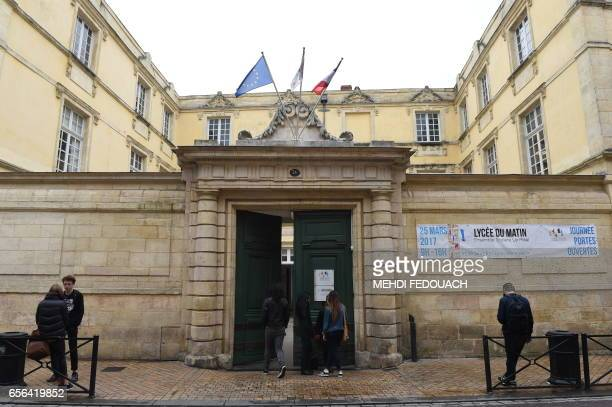 Students stand in front of Le Mirail High School in Bordeaux southwestern France on March 20 2017 This nonstandard high school follows the program of...