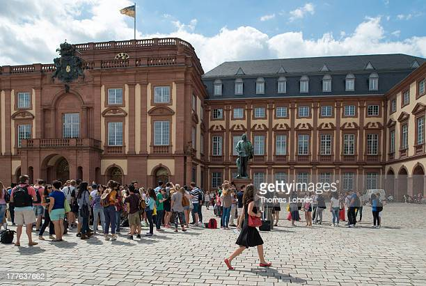 Students stand in front of the castle withe University of Mannheim on August 12 2013 in Mannheim Germany