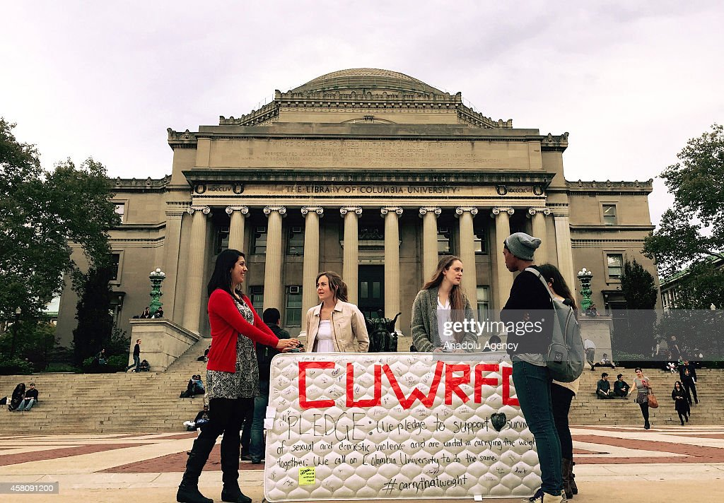Students stand in front of the Library of the Columbia University with a mattress in support of Emma Sulkowicz's project against sexual assault...