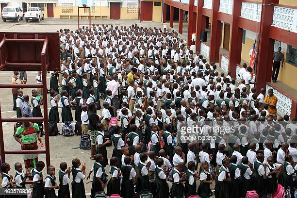 Students stand in line before heading to their classrooms at Don Bosco High School in the Liberian capital Monrovia on February 16 2015 Children...