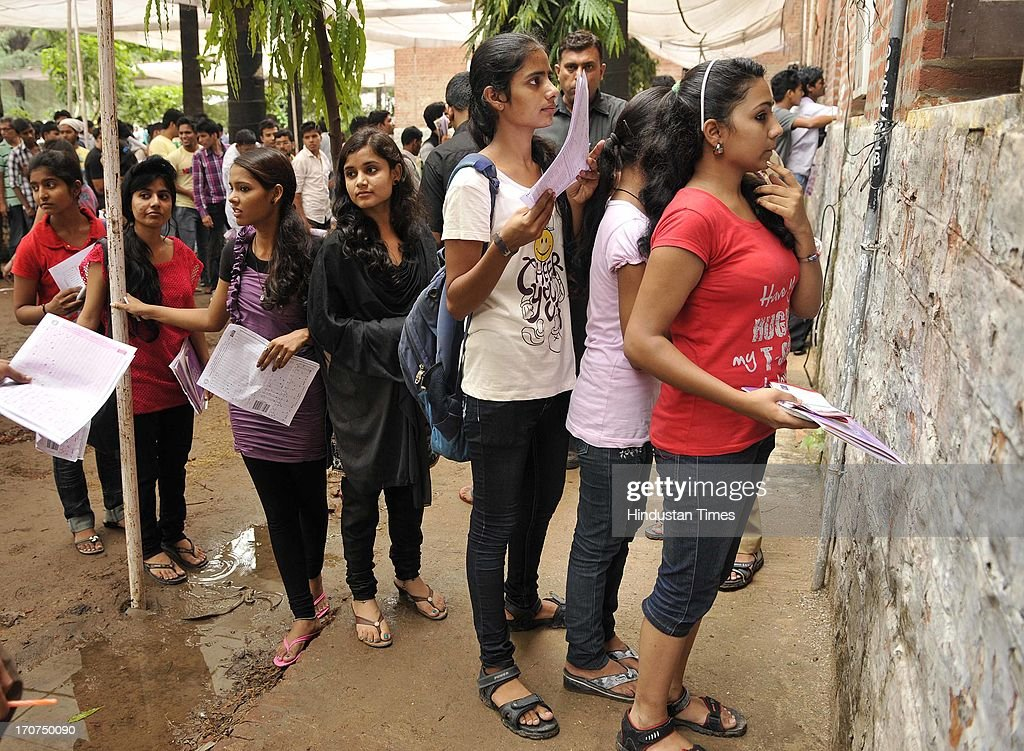 Students stand in queue to submit their admission forms for four year undergraduate programmes at North Campus Delhi University on June 17, 2013 in New Delhi, India. The University of Delhi (DU) will be releasing its first cut off list on June 27, 2013 for admission to its various four year undergraduate programmes. The cut offs are expected to be higher than last year since the applications too have soared.