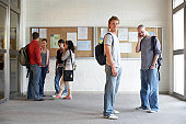 Students standing by notice board