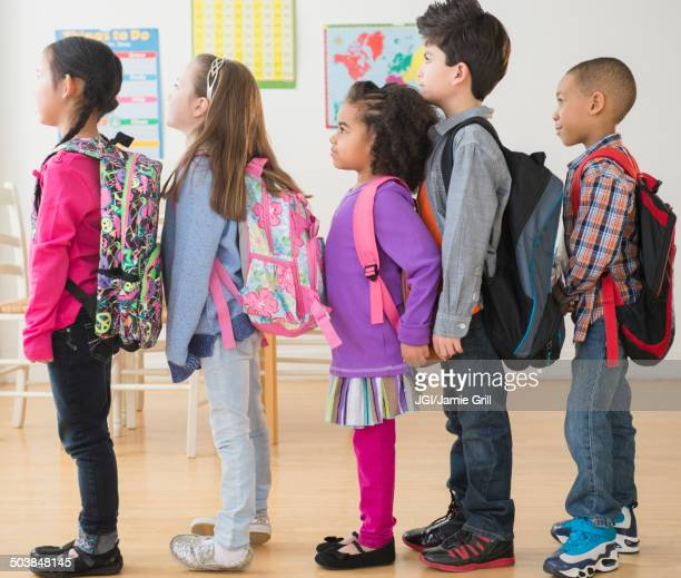 Students standing in line in classroom