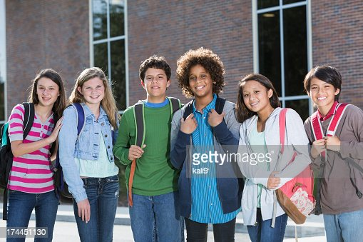 Students standing outside building
