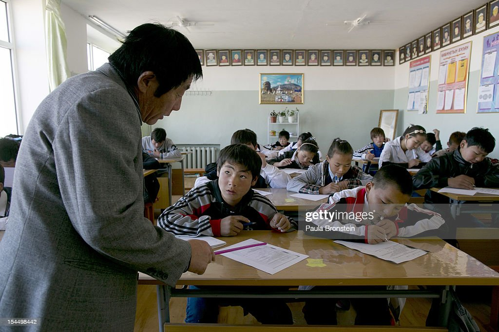 Students study in class at the Khanbogd Secondary school on October 13, 2012 in Khanbogd, Mongolia. The population of Khanbogd has doubled in the last few years along with the secondary school adding a new extension to accommodate the growing number of students since Oyu Tolgoi employs most of the people in the town.The Oyu Tolgoi copper and gold mine (translated means Turquiose Hill) is a combined open pit and underground mining project. While the construction continues open pit mining is currently underway with full production expected later in 2012. When the mine starts full operation the country will be set to become one of the world's top copper and gold producers with estimates of 450,000 tons of copper and 330,000 ounces of gold. Financing for the project has come in part from the Rio Tinto Group and an investment agreement between Ivanhoe Mines and the government of Mongolia. Mongolia's largest foreign investment project to date which is projected to add one-third of future value to the country's GDP. Many estimate Mongolia to be the world's fastest growing economy with an estimated $1.3 trillion in untapped mineral resources.