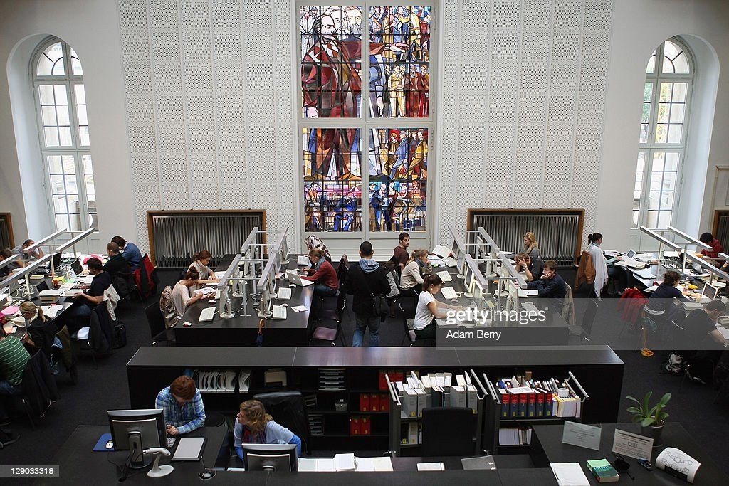 Students study legal texts under a stained glass window featuring Vladimir Ilyich Lenin, leader of the Russian October Revolution of 1917, in the law faculty library at Humboldt University prior to the beginning of the winter semester on October 11, 2011 in Berlin, Germany. German universities recorded a record 2.218 million matriculations in the 2010/2011 winter semester, a rise of 4.5%, and expect even more students in the coming winter semester, which starts in October. The end of compulsory military service in the Bundeswehr, the German armed forces, which went into effect earlier this year, is a major contributing factor to the rise in the numbers of students arriving at universities across the country.