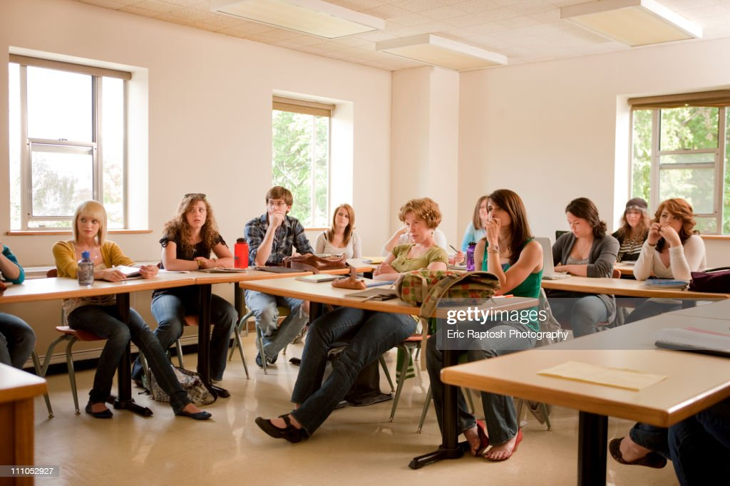 Students studying in classroom : Stock Photo