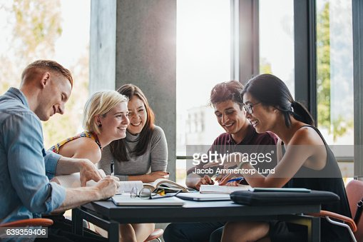 Students studying in college library : Stock Photo