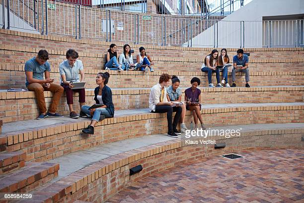 Students studying in groups outside