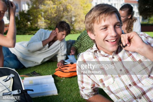 Students studying outdoors : Stock Photo