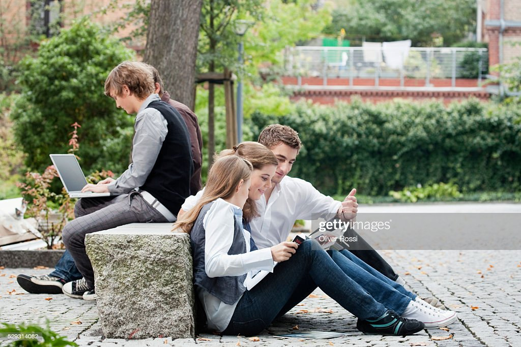 Students studying together outdoors : Foto stock