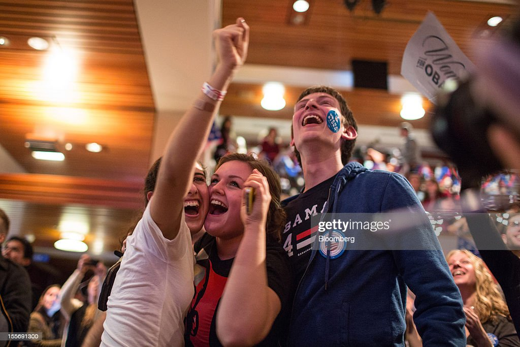 Students supporting U.S. President Barack Obama react as they watch election returns come in inside the Kennedy Forum at the Harvard University John F. Kennedy School of Government in Cambridge, Massachusetts, U.S., on Tuesday, Nov. 6, 2012. Obama, the post-partisan candidate of hope who became the first black U.S. president, won re-election today by overcoming four years of economic discontent with a mix of political populism and electoral math. Photographer: Scott Eisen/Bloomberg via Getty Images