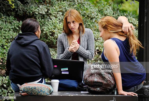 Students take a break on the campus of UCLA on April 23 2012 in Los Angeles California According to reports half of recent college graduates with...