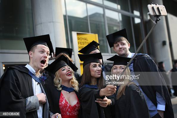 Students take a selfie ahead of their graduation ceremony at the Royal Festival Hall on October 13 2015 in London England Students of the London...