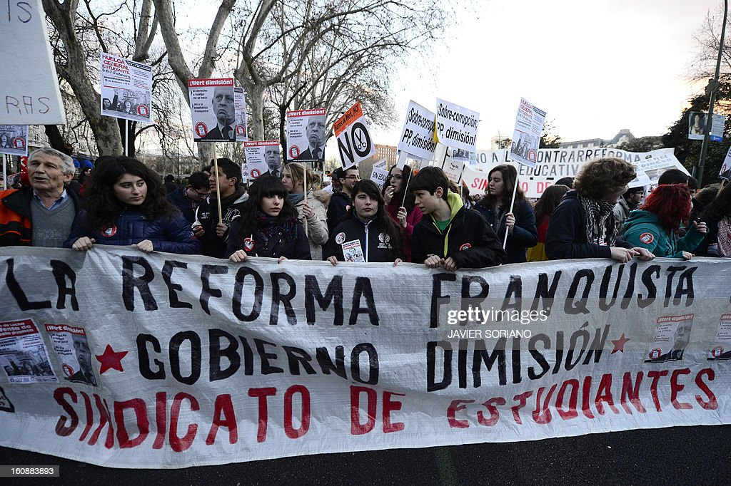 Students take part in a demonstration against government's budget cuts to education spending and a new education reform in Madrid on February 7, 2013. The national students' union says the government has cut five billion euros (6.8 billion USD) from spending on schools and universities as it fights to stabilise the public finances.