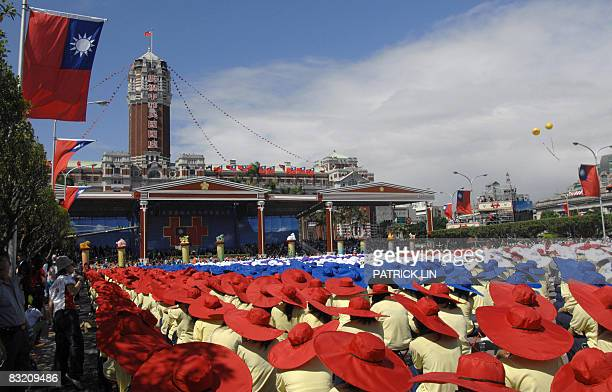 Students take part in the national day ceremony outside the Presidential Palace in Taipei on October 10 2008 President Ma Yingjeou urged confidence...