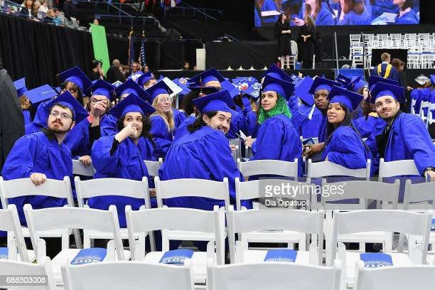 Students take their seats during The Fashion Institute of Technology's 2017 Commencement Ceremony at Arthur Ashe Stadium on May 25 2017 in New York...