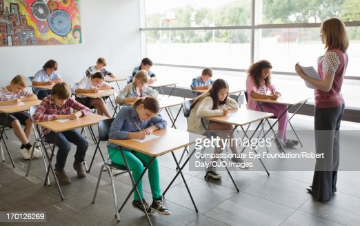 Students taking a test in classroom : Stock Photo