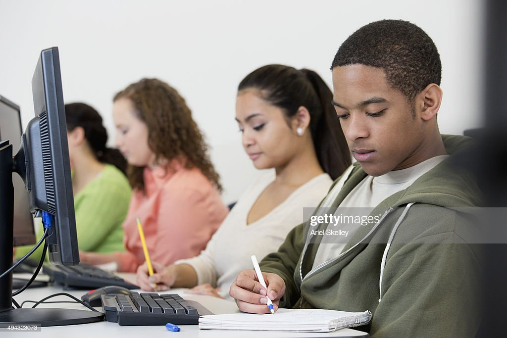 Students Taking Notes In Class Stock Photo | Getty Images