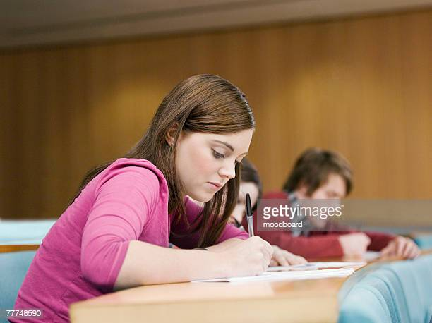 Students Taking Notes in Classroom