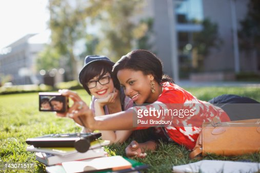 Students taking picture of themselves outdoors : Stock Photo
