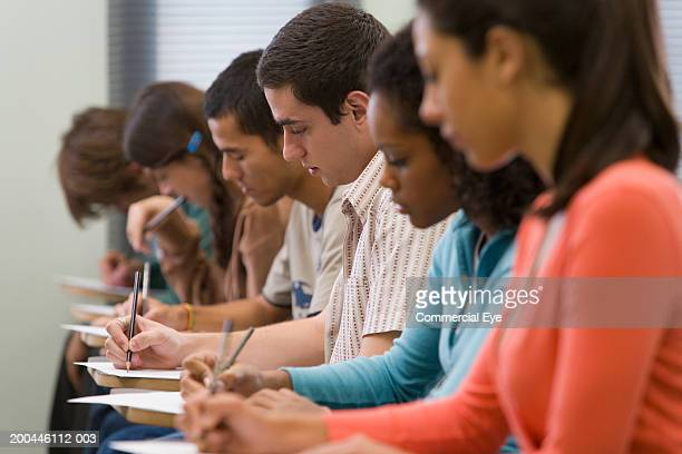 Students taking written examination, side view