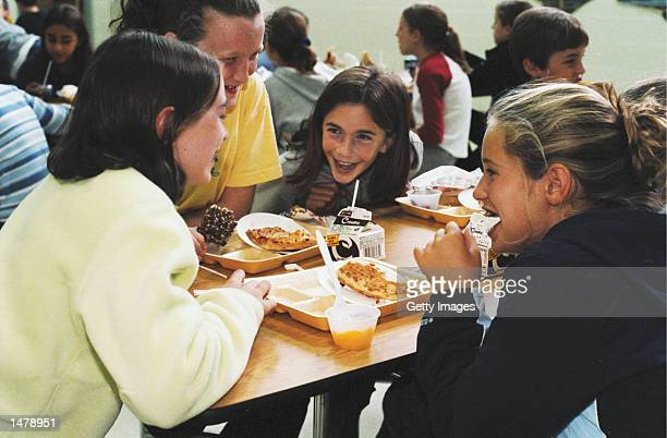 Students talk in the school cafeteria during lunch October 15 2002 at North Hampton School in North Hampton New Hampshire North Hampton School has...