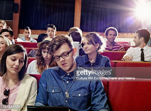 Students talking in class : Stock Photo
