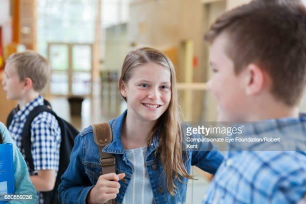 Students talking in corridor