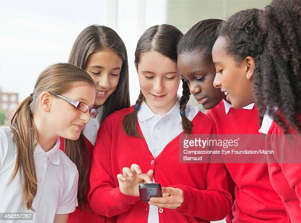 Students texting on mobile phone
