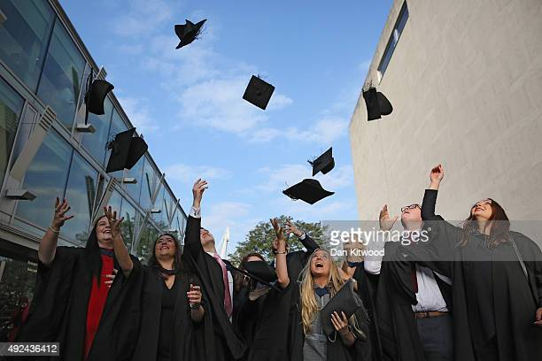 Students throw their caps in the air ahead of their graduation ceremony at the Royal Festival Hall on October 13 2015 in London England Students of...