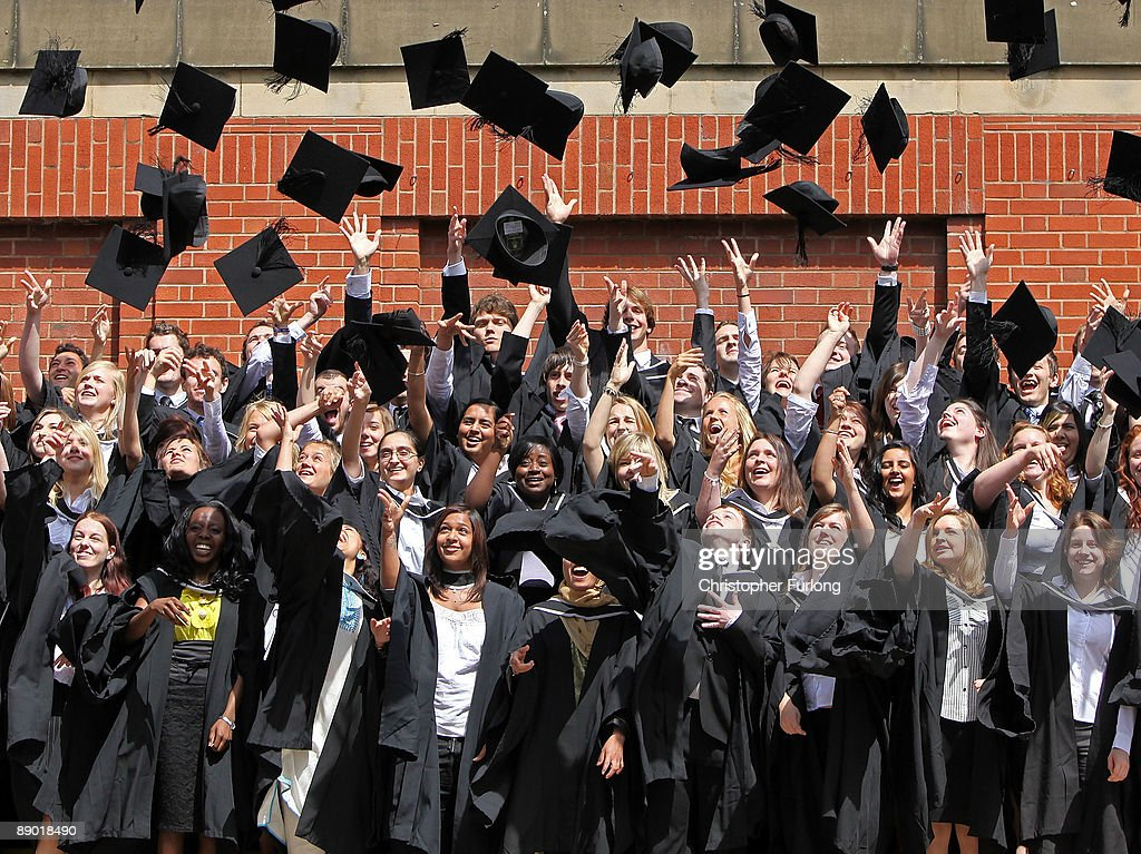 Students throw their mortarboards in the air during their graduation photograph at the University of Birmingham degree congregations on July 14, 2009 in Birmingham, England. Over 5000 graduates will be donning their robes this week to collect their degrees from The University of Birmingham. A recent survey suggested that there are 48 graduates competing for every job.