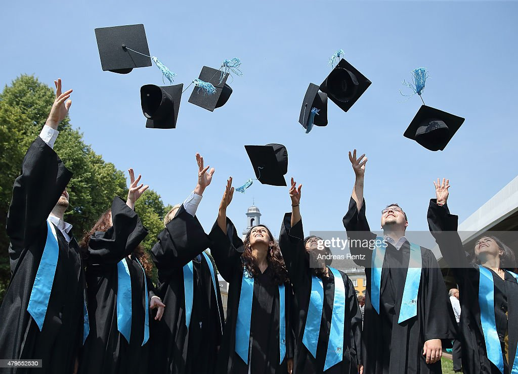 Students throw up their graduate caps during the 11th celebrations of the Rheinische FriedrichWilhelmsUniversitaet on July 4 2015 in Bonn Germany...