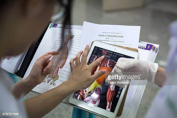 Students used iPads and textbooks for reference as they dissect cadavers at the Anatomy Lab of Chulalongkorn University on July 7 2015 in Bangkok...