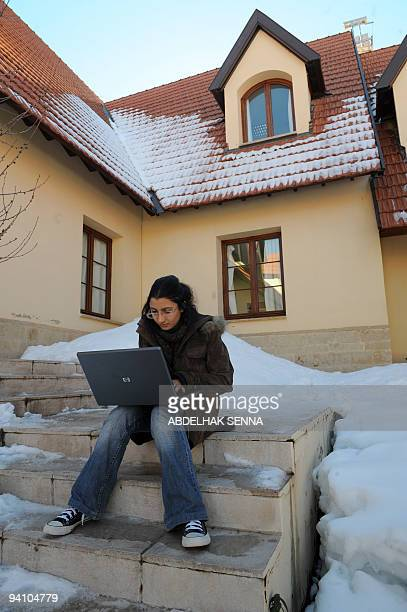 GUILBAUD A students uses a computer on the Campus of al Akhawayn Ifrane University on January 29 2009 in Ifrane The private university inaugurated in...